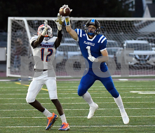 9/8/2017 Mike Orazzi | Staff Plainville High School''s Cody Marquis (1) and Bloomfield's Kamren Watkins (12) Friday night in Plainville.