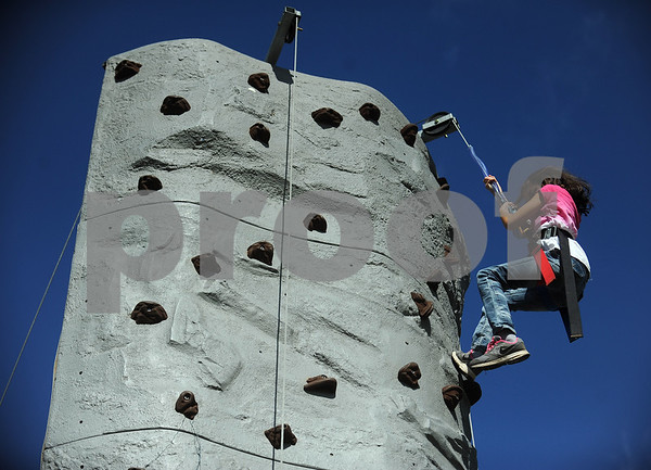 9/9/2017 Mike Orazzi | Staff Jackie Pena,9, on the climbing wall during the Main Street USA Festival held in Walnut Hill Park in New Britain Saturday.
