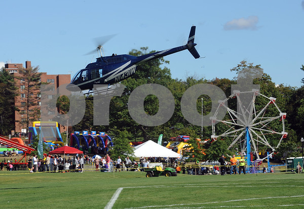 9/9/2017 Mike Orazzi | Staff Helicopter rides during the Main Street USA Festival held in Walnut Hill Park in New Britain Saturday.