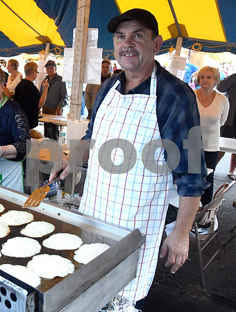 9/9/2017 Mike Orazzi | Staff Golik Marek serves potato pancakes during the Dozynki Festival held at Saint Stanislaus Church in Bristol Saturday.