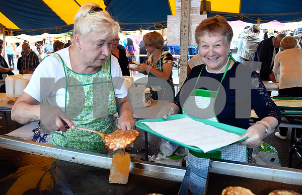 9/9/2017 Mike Orazzi | Staff Jadwiga Masi and Teresa Chmielewska serve potato pancakes during the Dozynki Festival held at Saint Stanislaus Church in Bristol Saturday.