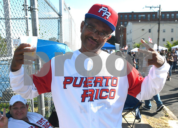9/9/2017 Mike Orazzi | Staff Efraim Gomez during the Puerto Rican Festival held on High Street in New Britain Saturday.