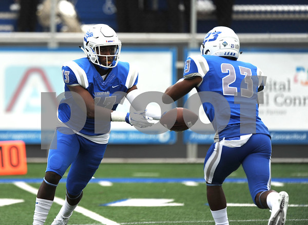 9/9/2017 Mike Orazzi | Staff CCSU's Najae Brown (13) hands off the opening kickoff to Tajik Brown (23) during Saturday's game with Fordham in New Britain.