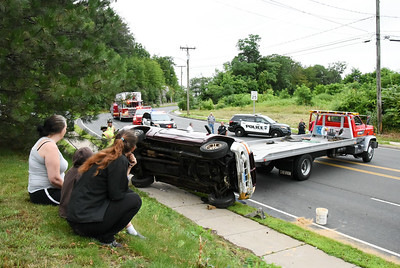 passerby-help-two-people-out-of-rollover-accident