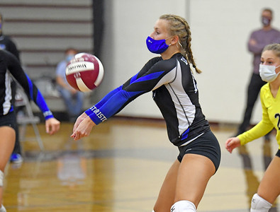 area-girls-volleyball-players-adjusting-to-masks-during-unique-season