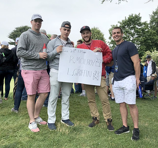 fan-finds-himself-in-middle-of-action-after-getting-hit-by-stray-mcilroy-shot-at-travelers-championship-saturday