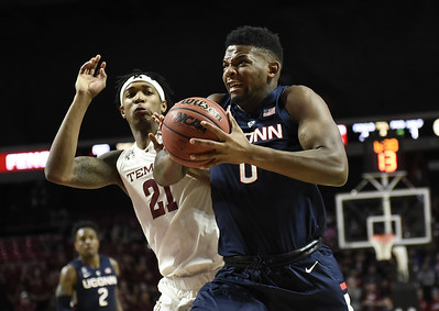 alston-pierrelouis-lead-temple-in-rout-of-uconn-mens-basketball